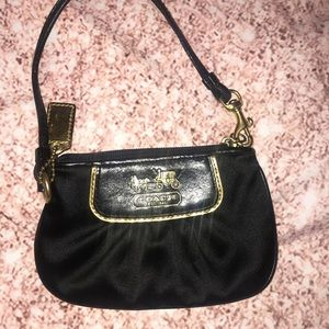 Coach Wristlet in Black and Gold Lining